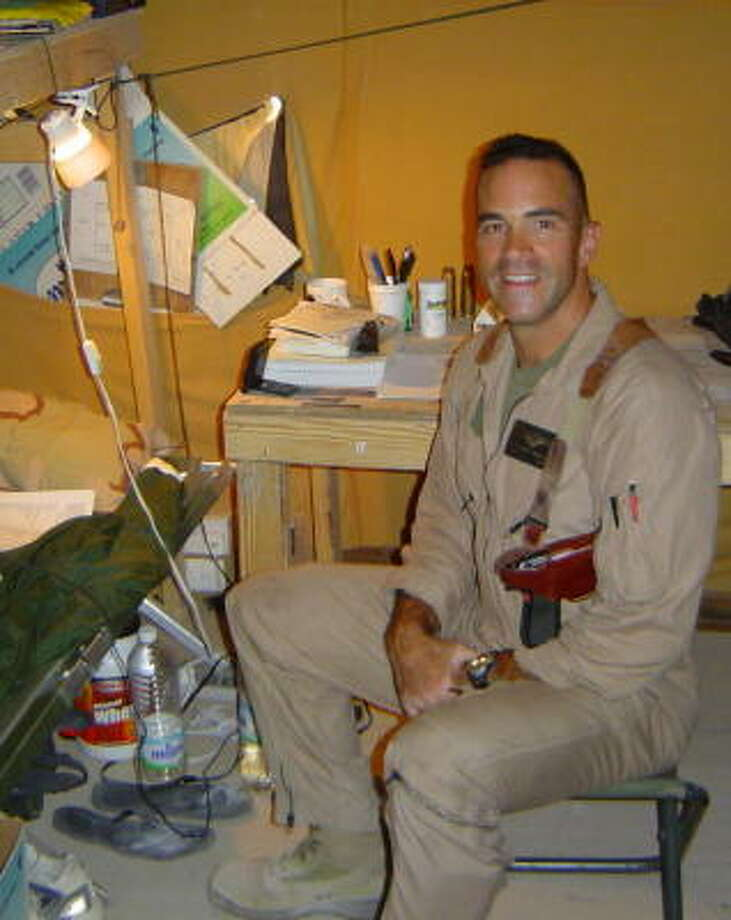 Marine Maj. John Ruocco is seen in this 2004 photograph relaxing in his quarters in Anbar Province in Iraq. Photo: HANDOUT PHOTO, SAN ANTONIO EXPRESS-NEWS
