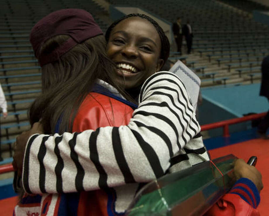 Westside's Diamond Dixon, right, embraces Ibukun Blessing Mayungbe of Lamar following the HISD letter of intent signing ceremony. Photo: Brett Coomer, Chronicle