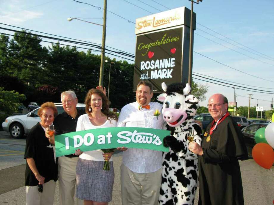 "From left to right: Marianne Leonard, Stew Leonard, Sr., Roseanne and Mark, Wow the Cow, and Les Slater who served as the reverand for ""I Do at Stew's."" Slater is director of operations at the Norwalk store. Photo: Contributed Photo"