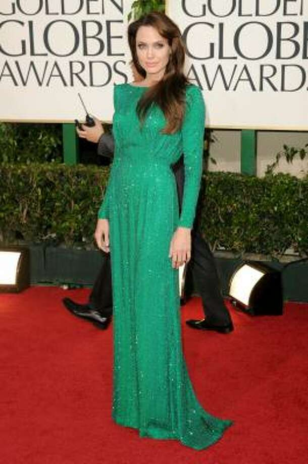 Angelina Jolie got rave reviews for her emerald Versace gown at the Golden Globes. Photo: Jason Merritt, Getty Images