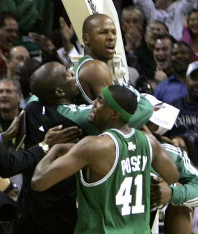 Ray Allen is carried off the court after he gave the Celtics a lift with a game-winning 3-pointer at the buzzer Saturday night. Photo: CHUCK BURTON, ASSOCIATED PRESS