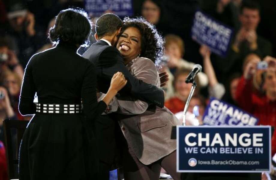 "Democratic presidential candidate Sen. Barack Obama and Oprah Winfrey hug at a campaign appearance Saturday in Des Moines, Iowa, as Obama's wife, Michelle, looks on. ""Experience in the hallways of government isn't as important to me as experience on the pathway of life,"" Winfrey said. Photo: CHARLES NEIBERGALL, ASSOCIATED PRESS"