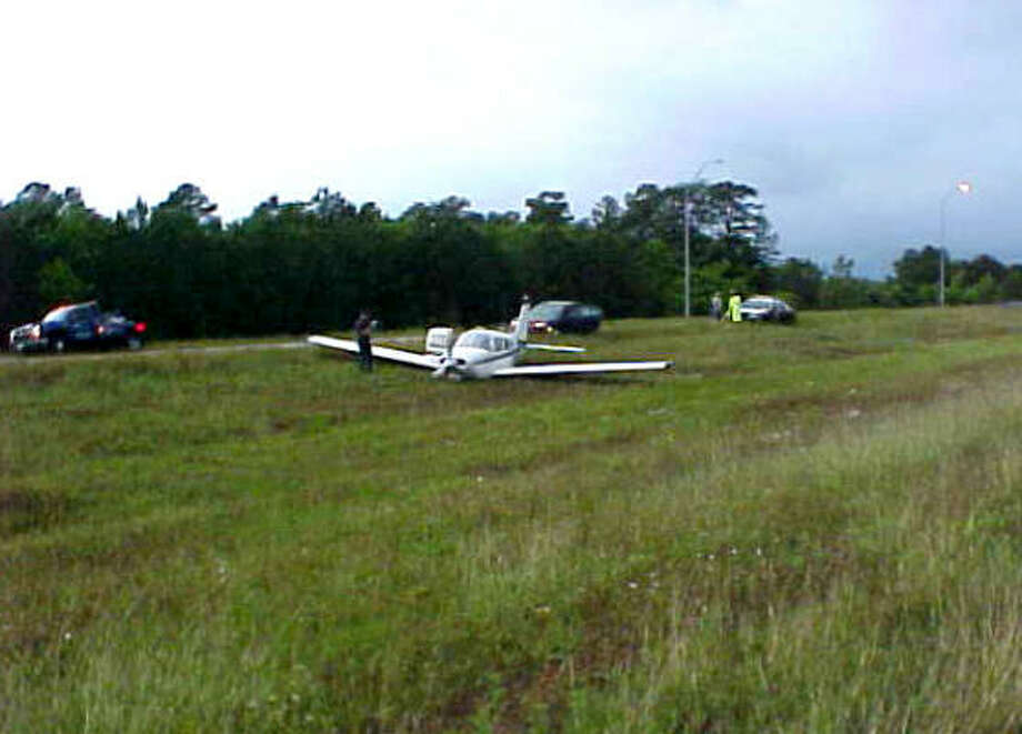 A Texas City pilot landed his single-engine Piper airplane on the median of U.S. Highway 90 after the engine failed this morning. Photo: Mike Williams, Special To The Chronicle