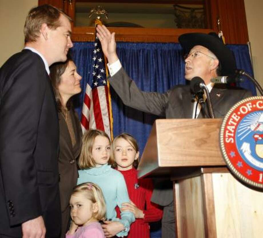 U.S. Senate-designate Michael Bennet, left, joins his wife, Susan Daggett, and their daughters, Anne, 4, Caroline, 9, and Halina, 7, in accepting a blessing from U.S. Sen. Ken Salazar, D-Colo., on Saturday. Bennet has been selected to succeed Salazar, whom President-elect Barack Obama chose to be the U.S. secretary of the interior. Photo: DAVID ZALUBOWSKI, ASSOCIATED PRESS