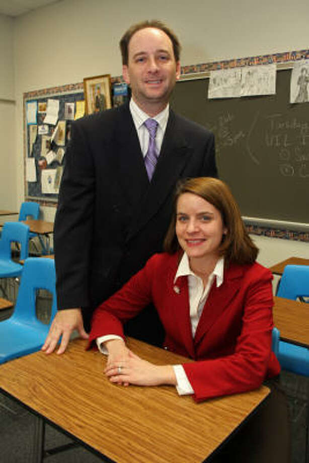 Elizabeth Irish, Texas history teacher at Taylor High School, and her husband, John Irish, Texas history teacher at Seven Lakes High School, head their respective University Interscholastic League Academic Decathlon teams. Photo: Suzanne Rehak, For The Chronicle