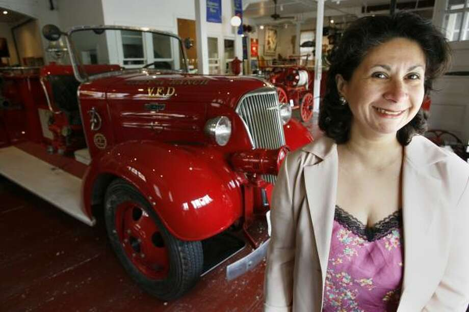 Houston Fire Museum Executive Director Emily Ponte poses in a building on Milam leased for $1 a year. Some sub-market lease deals the city has with nonprofits have drawn attention. Photo: KEVIN FUJII, CHRONICLE