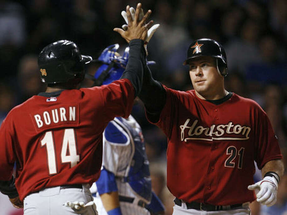Ty Wigginton, right, celebrates with Michael Bourn after hitting a two-run home run against the Chicago Cubs during the fifth inning on Wednesday at Wrigley Field in Chicago. Photo: Nam Y. Huh, AP