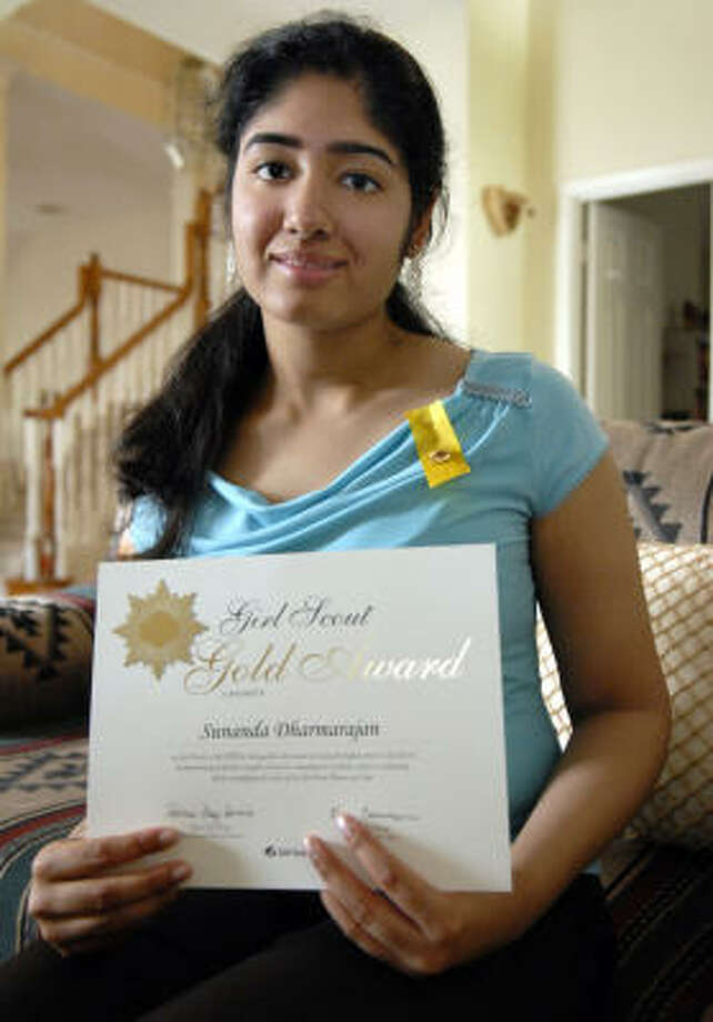 Sunanda Dharmarajan holds her Gold Award certificate. Photo: Kim Christensen, For The Chronicle