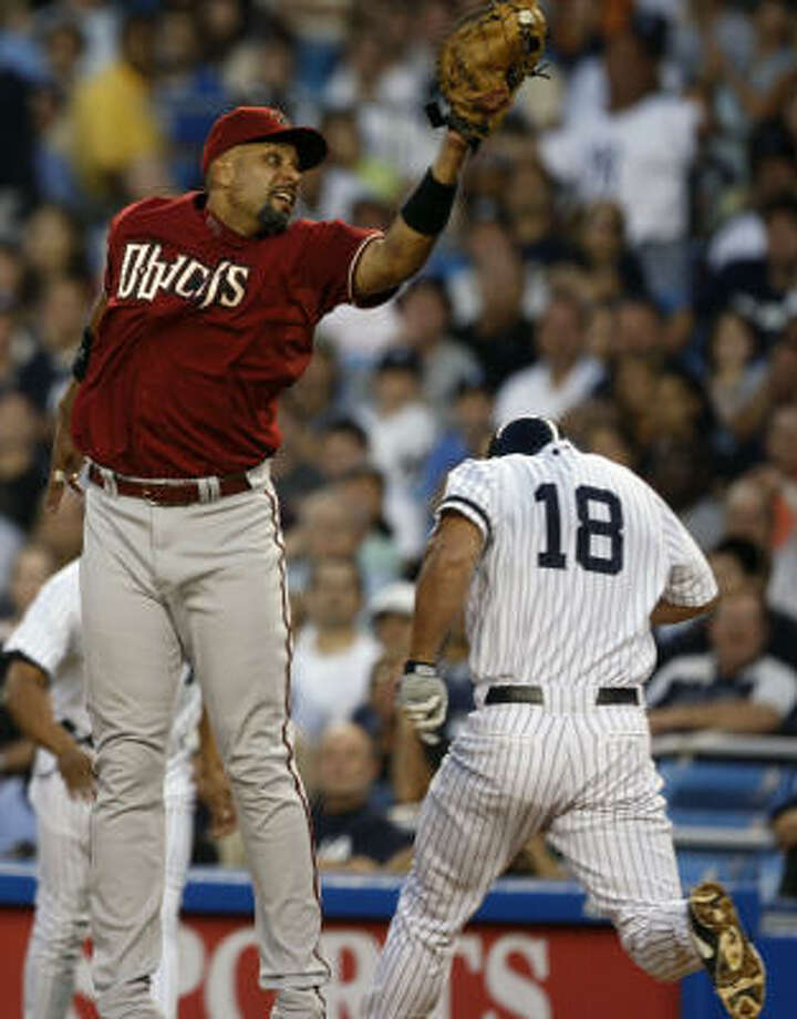 Arizona Diamondbacks first baseman Tony Clark comes off the bag, and Johnny Damon is safe. Damon and the Yankees have won 10 of their last 12. Photo: Julie Jacobson, AP