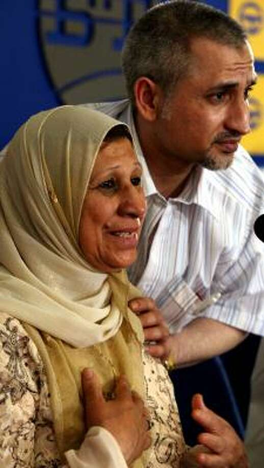 Dr. Ashraf al-Hazouz, with his mother, has said he will testify that he was tortured in Libya in an investigation of the charges. Photo: VALENTINA PETROVA, AP