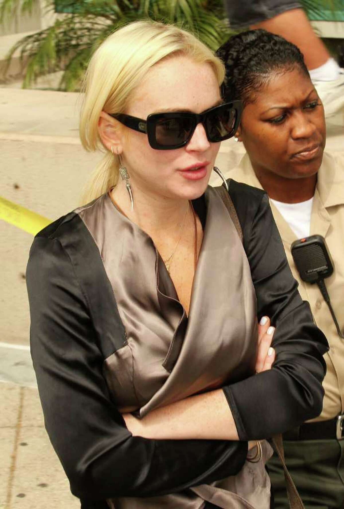 Actress Lindsay Lohan leaves the Airport Branch Courthouse for her progress report hearing in Los Angeles, California. Judge Stephanie Sautner did not find Lohan in violation of her probation but indicated that Lohan should speed up her community service if she is to complete the 480 hours within a year as required by the court. Lohan is on probation after she pleaded no contest to a misdemeanor count of theft involving a necklace taken from a jewelry store in Venice, California.