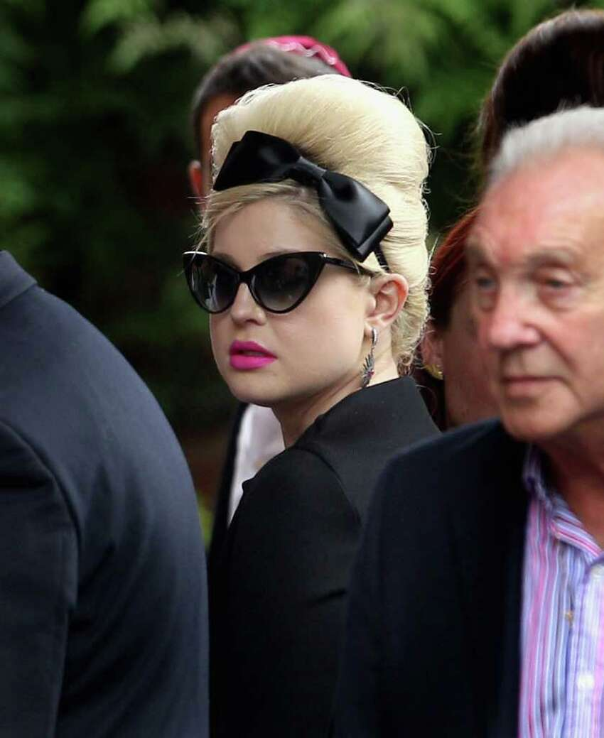 Kelly Osbourne arrives for the cremation of Amy Winehouse at Golders Green Crematorium on Tuesday in London, England. Winehouse was found dead in her flat in North London July 23, 2011.