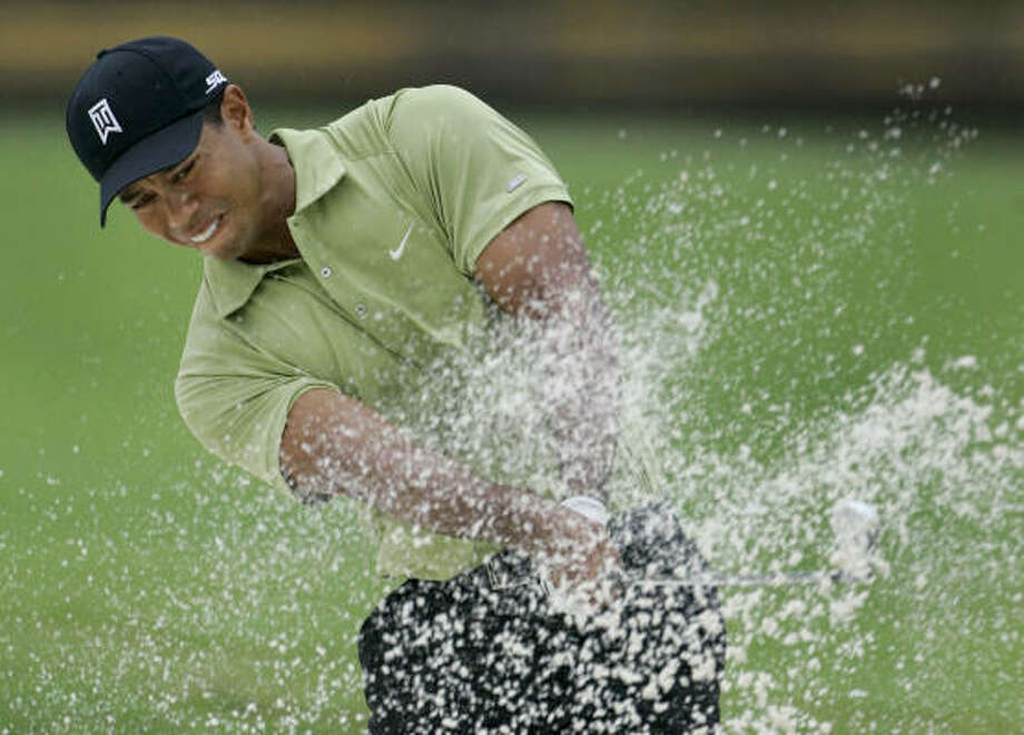 Tiger Woods' 13-under 127 is his best start since he was at 15-under at Firestone in 2000, a tournament he won by 11. Photo: Rob Carr, AP