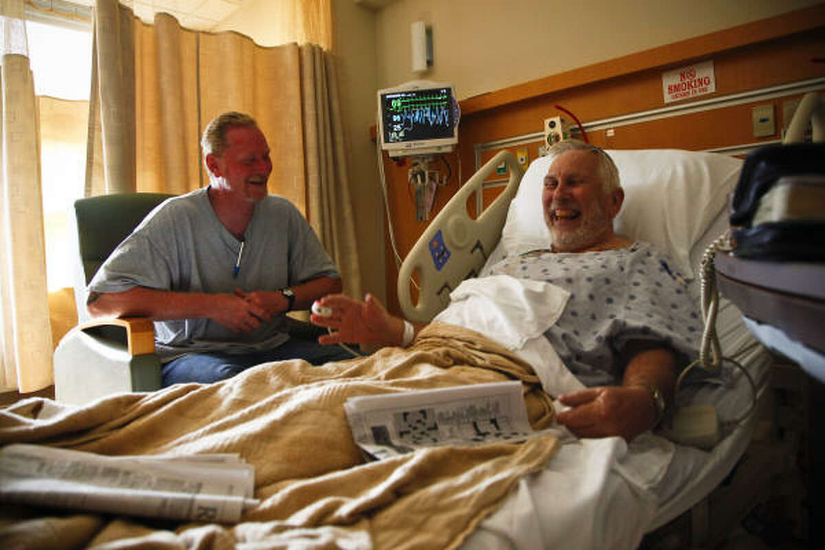 Michael Eubanks, left, visits his mentor, Rabbi Jim Pratt, at St. Luke's The Woodlands Hospital last week after Pratt was hospitalized with pneumonia. Eubanks was recently released after serving more than 30 years of a life prison sentence for capital murder.