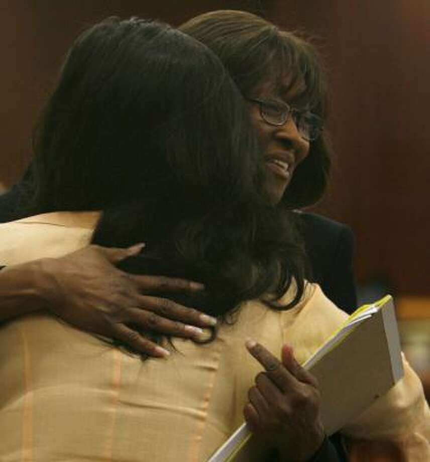 Former TSU President Priscilla Slade hugs Angela Richardson, a member of Elite Ladies of Expression. The group was in court to support Slade. Photo: KAREN WARREN, CHRONICLE