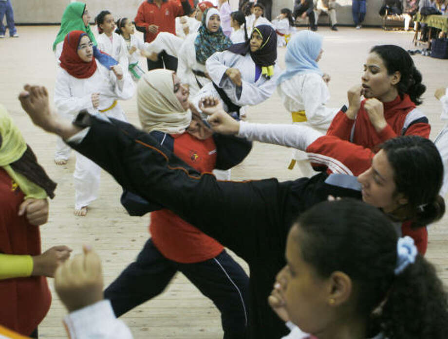 Egyptian girls train to protect themselves against sexual harassment in Zagazig, a city of 1 million people north of Cairo.  A recent study by a Cairo-based women's rights group shows that 83 percent of Egyptian women and 98 percent of foreign women surveyed said they were harassed. Of the men surveyed, 62.4 percent said they harassed women. Photo: Amr Nabil, AP