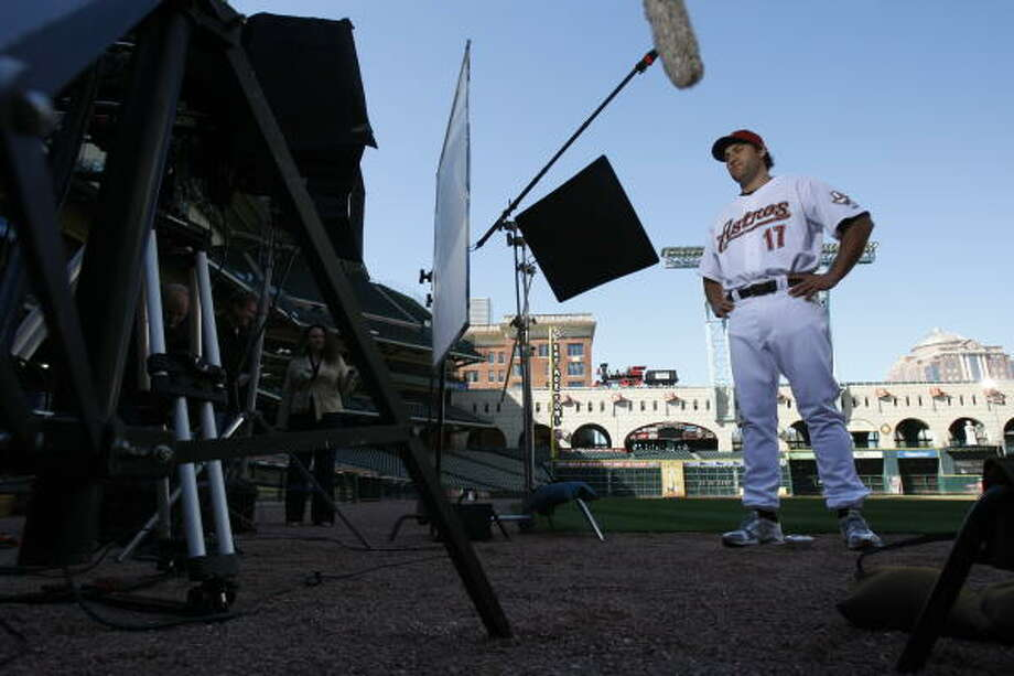 Houston Astros first baseman Lance Berkman performs a script during filming of a video public service announcement regarding stroke for Methodist Hospital at Minute Maid Park. With the economy in the tank, some companies are scaling back their sponsorship of sports teams and stadiums. Photo: JULIO CORTEZ, Chronicle