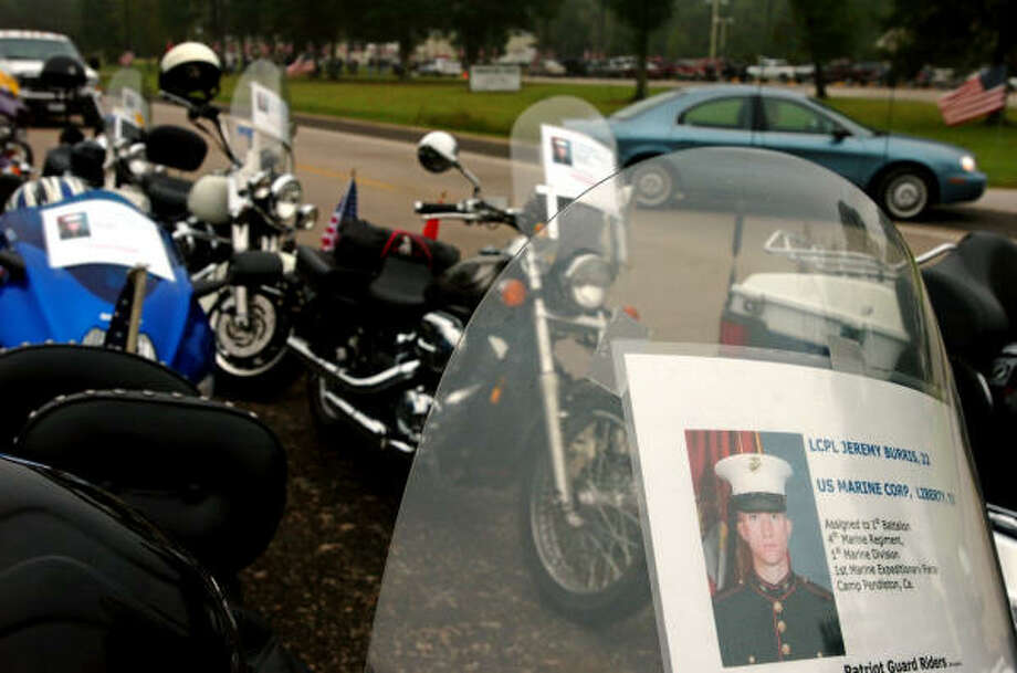 Windshield posters of U.S. Marine Corps Lance Cpl. Jeremy Burris remind Patriot Guard riders why they ride: to honor fallen American military service personnel. They were in Liberty on Tuesday for Burris' funeral. Photo: Mark M. Hancock, The Beaumont Enterprise