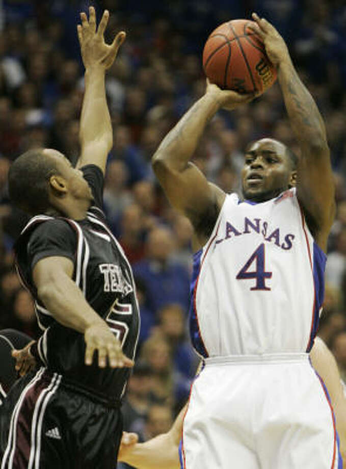 Kansas guard Sherron Collins, right, could pick up some hardware as an individual and with the Jayhawks. Photo: Orlin Wagner, AP
