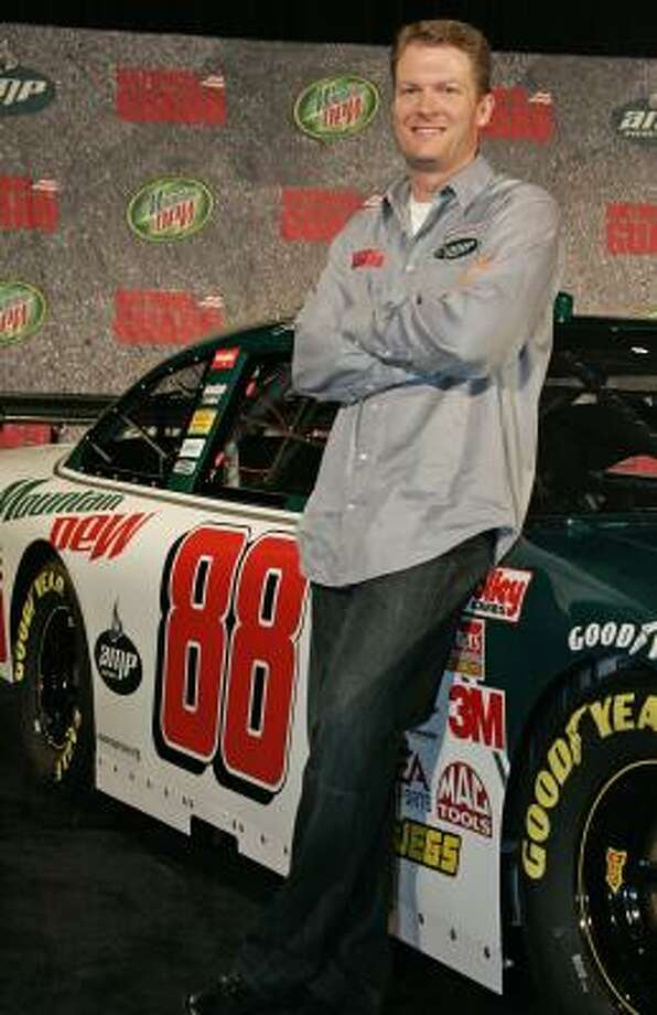 Dale Earnhardt Jr. stands with one of his 2008 cars after a news conference by Hendrick Motorsports announcing the sponsor and number for his car beginning in 2008. Photo: RALPH LAUER, MCCLATCHY-TRIBUNE