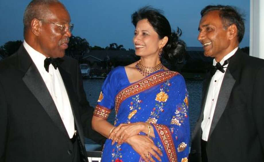 Renu Khator, center, and her husband, Suresh, right, chat with Bob Samuels, a board member of the Moffitt Cancer Center and Research Institute in Florida, in 2005. During her four years as provost of the University of South Florida, Khator raised millions of dollars from government and private sources. Her fundraising efforts led to the university's largest donation ever — a gift worth $34.5 million from a Tampa couple. Photo: AMY SCHERZER, ST. PETERSBURG TIMES FILE