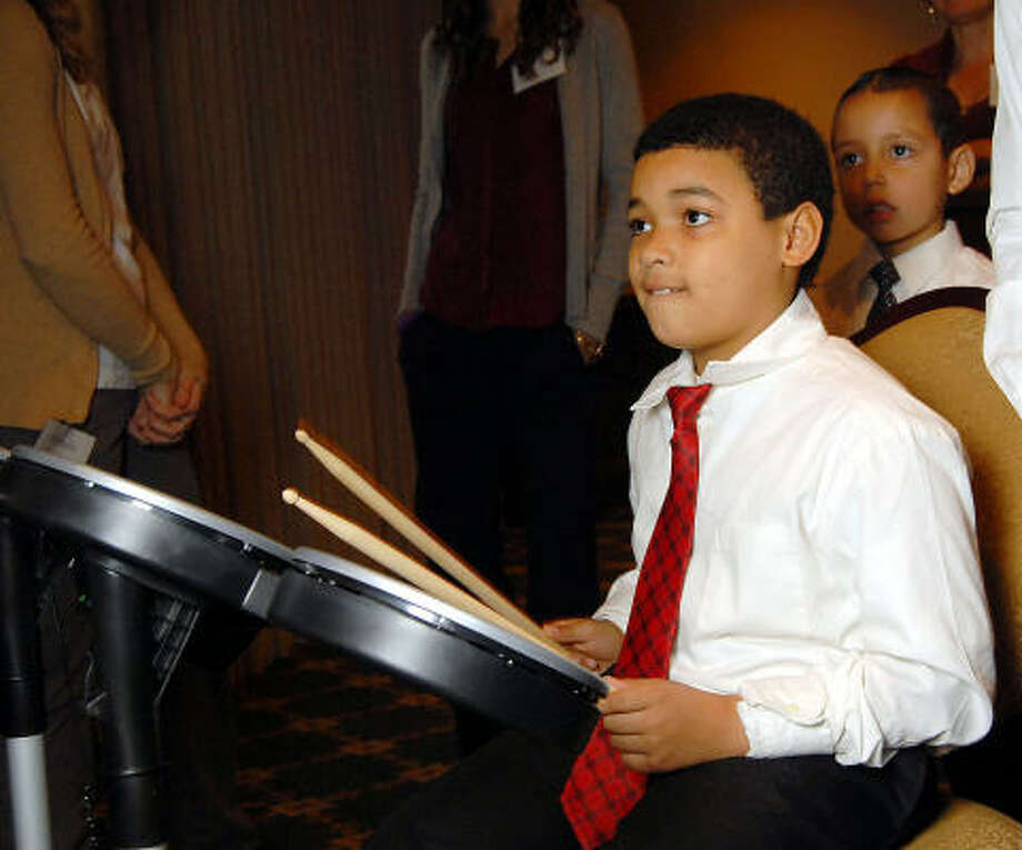 Klaudio Grilo, 9, plays drums at the Houston Symphony League's annual Magical Musical Morning event. Photo: Dave Rossman, For The Chronicle
