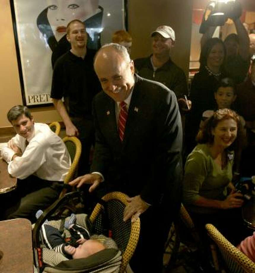 Republican presidential hopeful Rudy Giuliani greets 5-month-old Birch Carter in Clayton, Mo. Photo: JEFF ROBERSON, AP
