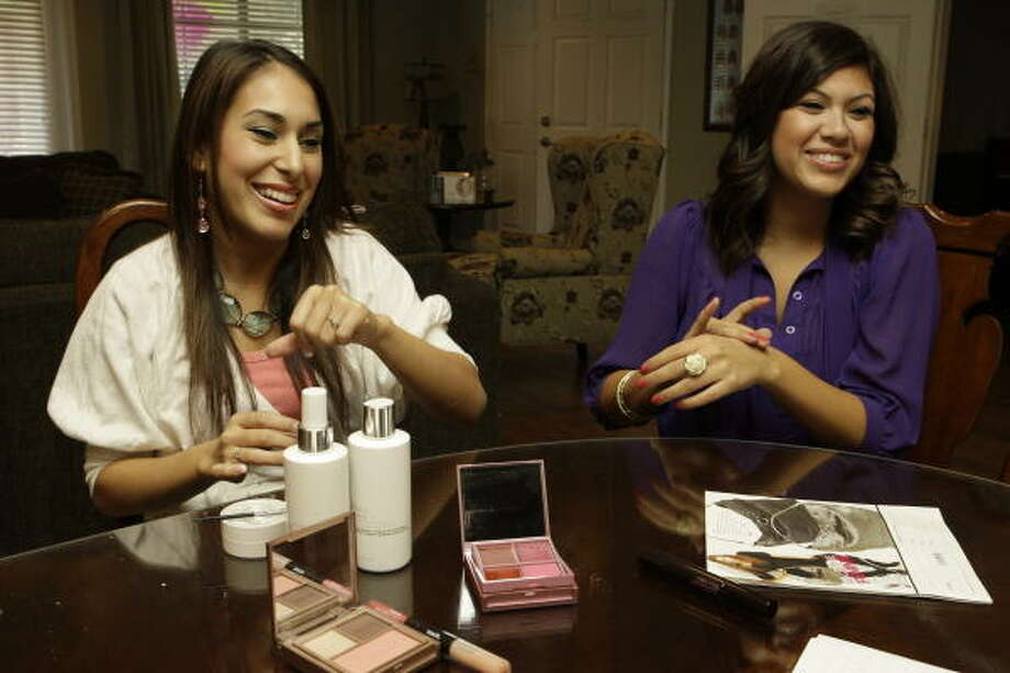 Corina Barrera, left, and Jennifer Farias, both juniors at the University of Houston, talk about selling Mark beauty products. Photo: Melissa Phillip :, Chronicle