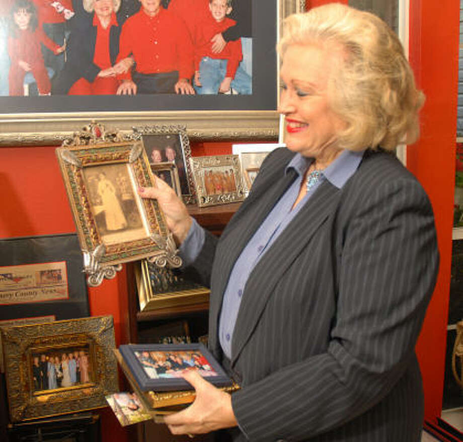 The Woodlands resident Pat Spackey holds photographs of her ancestors. Spackey's great-great-great grandfather, Charles Stewart, designed the State of Texas flag. Photo: David Hopper, For The Chronicle