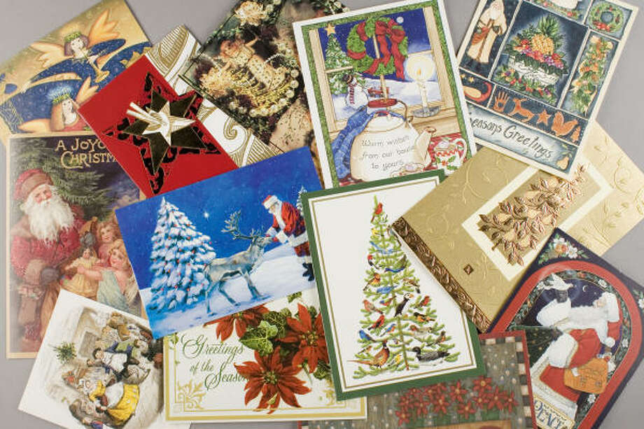 Don't let those old Christmas cards go to waste; turn the colorful clutter into a holiday treasure. Photo: Buster Dean, Chronicle