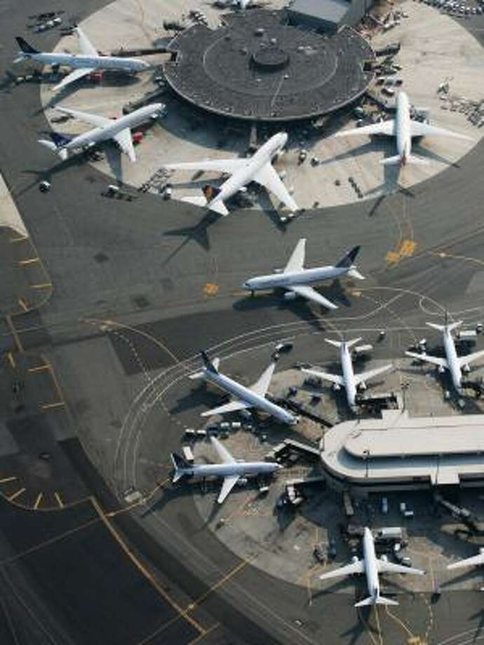 Passenger planes are parked at Newark Liberty International Airport. Limiting flights at the airport could have an adverse impact on Continental Airlines. Photo: MARK LENNIHAN, ASSOCIATED PRESS FILE
