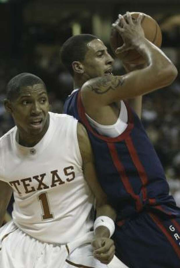 Saint Mary's forward Diamon Simpson (right) grabs a defensive rebound in front of Texas forward Gary Johnson, who spent the early part of the season recovering from an undisclosed heart condition. Photo: Harry Cabluck, AP