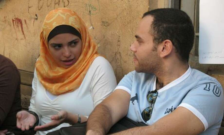 Many Egyptians complain that ordinary people are harassing unveiled women and unmarried couples, even if they're just classmates like these at a Cairo university. Some officials wonder if the emerging reformation poses a threat to President Hosni Mubarak's secular, authoritarian government. Photo: MIRET EL NAGGAR, MCT