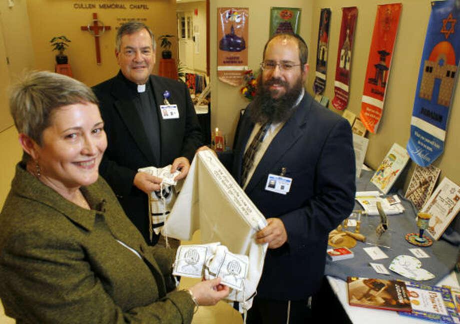 Janie Stevens, the Rev. Gary H. Jones and Rabbi Eliezer Lazaroff, right, believe Peace Village is a valuable teaching tool. Photo: Steve Ueckert, Chronicle