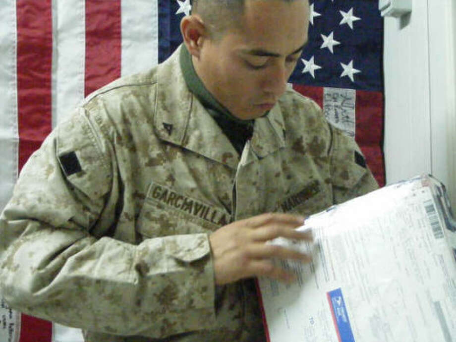 Marine Lance Cpl. Juan Garcia Villa and his 51-member platoon serving in Baghdad, Iraq, have received letters, cards and crayon pictures from Sneed Elementary School pupils and care packages from the staff. Photo: Courtesy Of Juan Garcia Villa