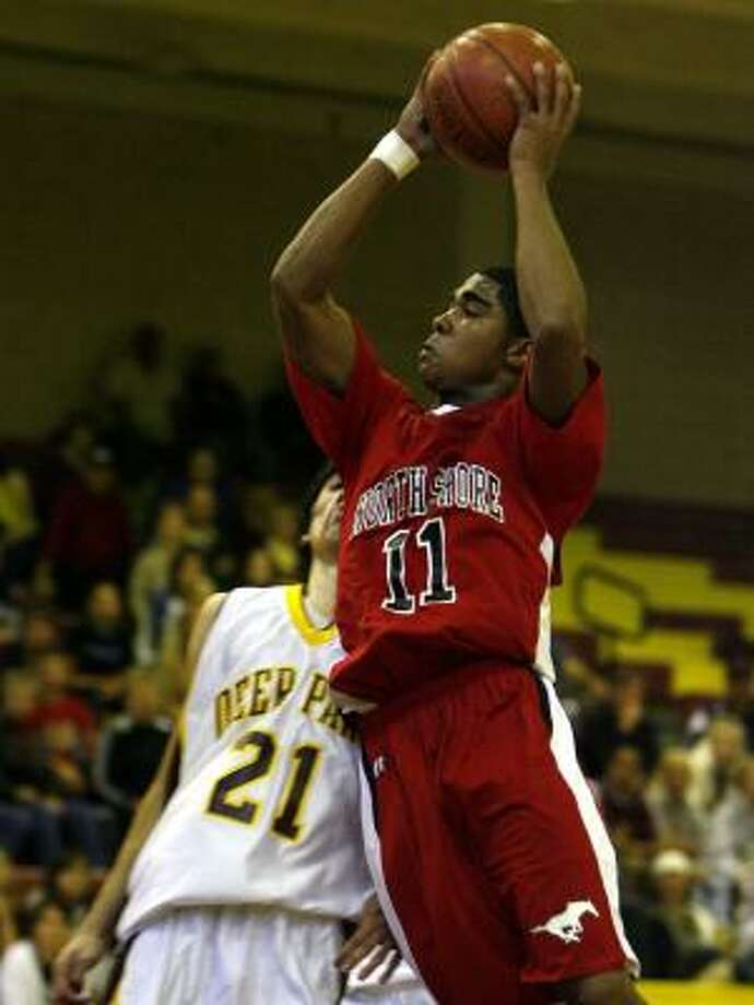 Jeremiah McGinty, moving past Deer Park's Adrian Morales, did it all for North Shore with 13 points, seven rebounds and six steals. Photo: JAMES NIELSEN, CHRONICLE