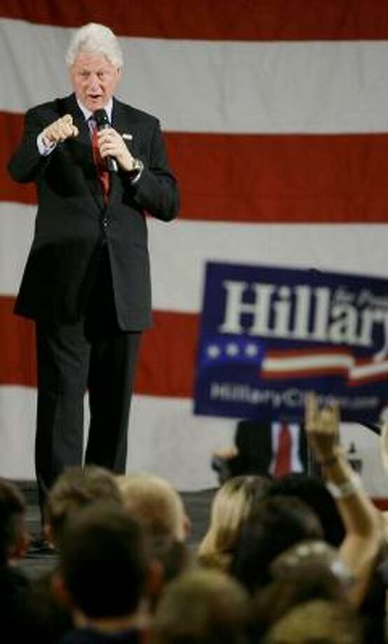 Former President Clinton campaigns for his wife Thursday in Rhode Island. Photo: STEPHAN SAVOIA, AP