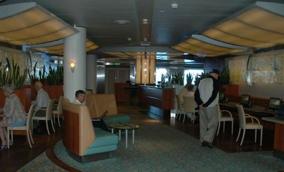 The Internet Center on the Diamond Princess cruise ship includes dozens of computers. A snack bar is available for passengers who stay online for long periods. Photo: HARRY SHATTUCK, CHRONICLE