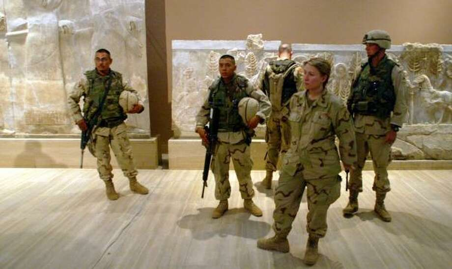 U.S. soldiers stand guard at the exhibit in Baghdad. Photo: MIKHAIL METZEL, ASSOCIATED PRESS
