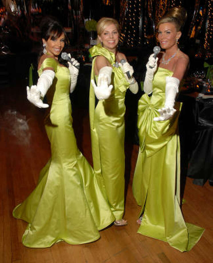 Jana Fant, from left, Laura Spalding and Debra Grierson put on the glitz at Jones Hall, where they chaired the Society for the Performing Arts Dream Girls Gala. They had their matching gowns specially made for the gala. Photo: Dave Rossman, For The Chronicle