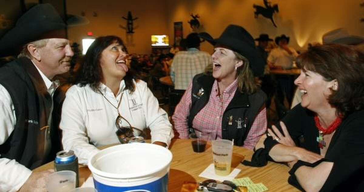 From left, Mark Smith, Phyllis Cutrer, Cathy Levandowski and Julia Powers unwind Wednesday.