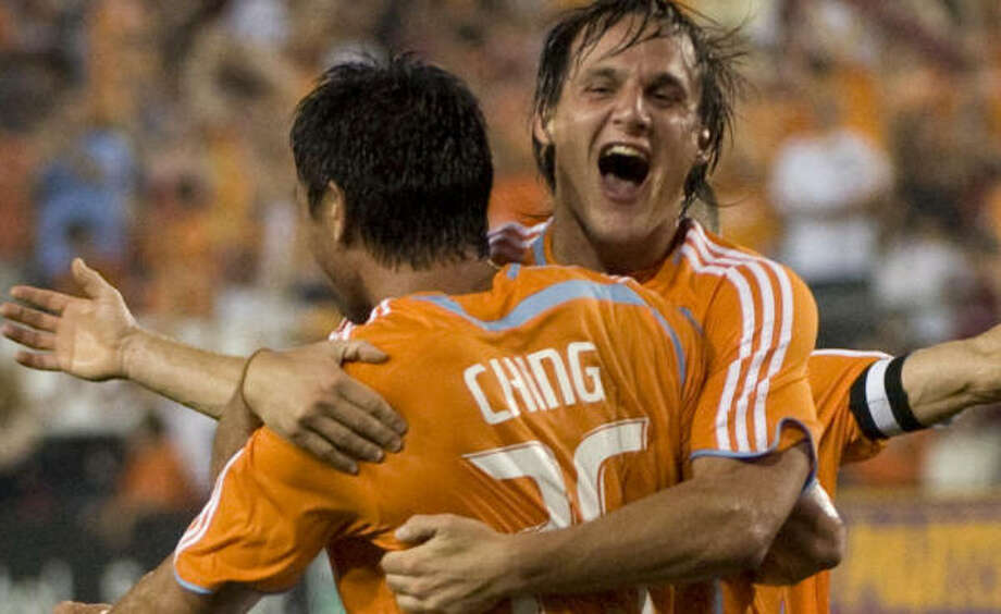 The Dynamo's Franco Caraccio, back, and teammate Brian Ching celebrate Ching's first-half goal. Photo: Smiley N. Pool, Chronicle