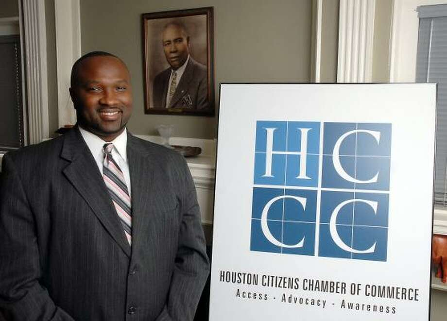 Jeffrey Boney is the new Houston Citizens Chamber of Commerce president. Behind him is a portrait of the group's founder J.E. Robinson Sr. Photo: DAVE ROSSMAN, FOR THE CHRONICLE