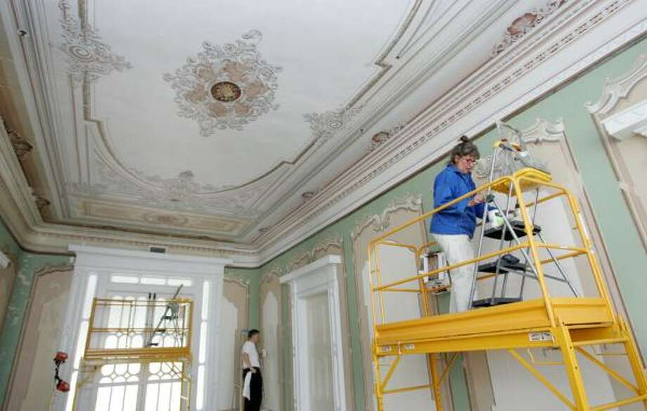 Linda Croxson and Philip Ward of Slate Mills, Va., restore the interior of Beauvoir, Jefferson Davis' home, in preparation for its reopening. Several months of work remain. Photo: JAMES EDWARD BATES, BILOXI SUN-HERALD/MCT