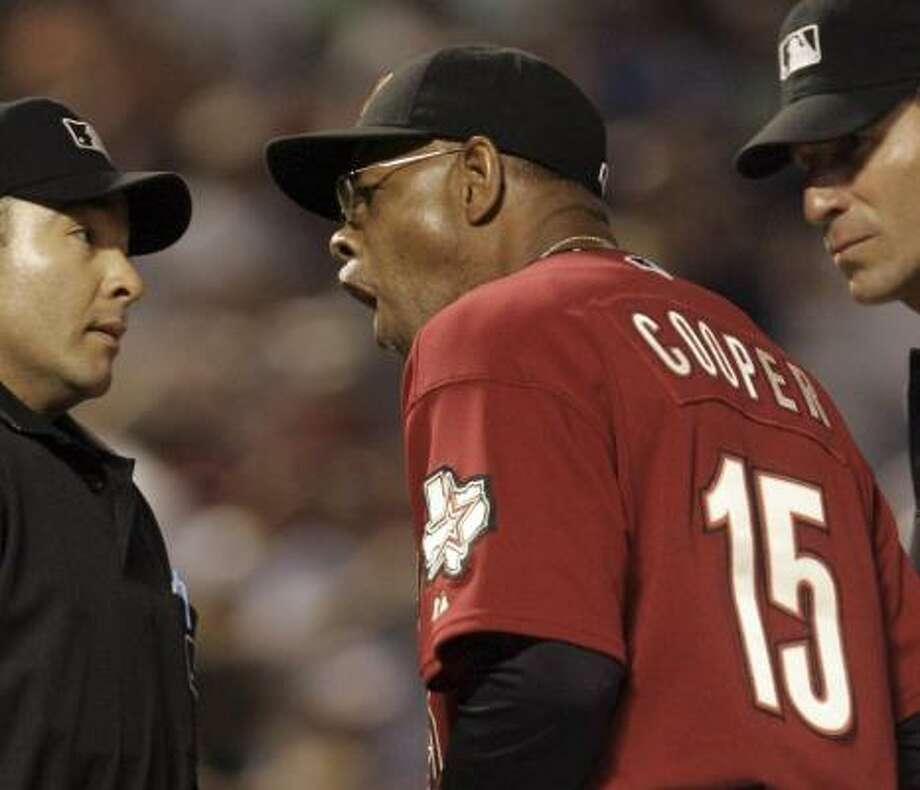 As manager, Cecil Cooper has many more pressures and responsibilities than he did as an assistant. Photo: LM Otero, AP