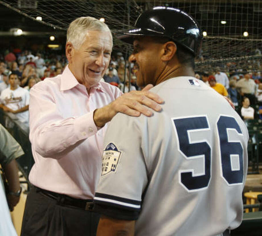 Astros owner Drayton McLane greets one of his former employees, Tony Pena,  before the Astros-Yankees game on Friday. Photo: Karen Warren, Chronicle