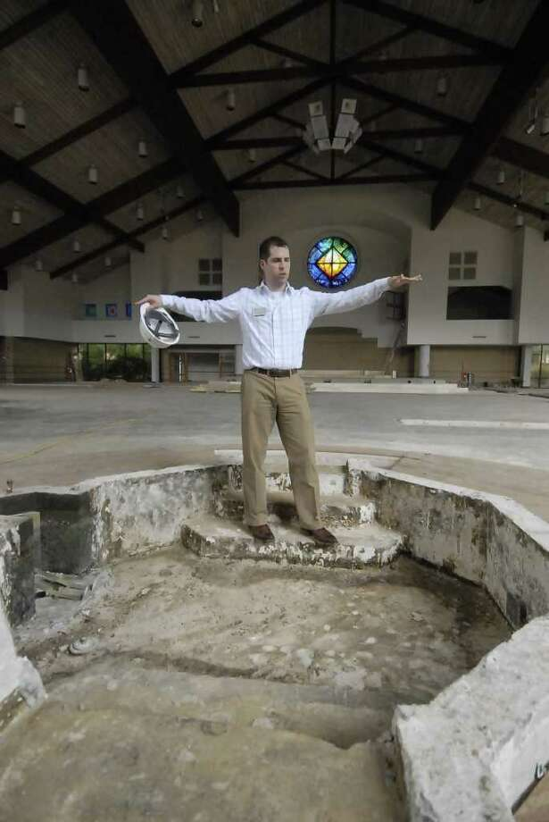 Prince of Peace Catholic Community communications director Charles Butler describes and stands in the future baptismal pond under construction at Prince of Peace Catholic Community Thursday 6/23/11. Photo by Tony Bullard. Photo: Tony Bullard / Credit: for the Chronicle