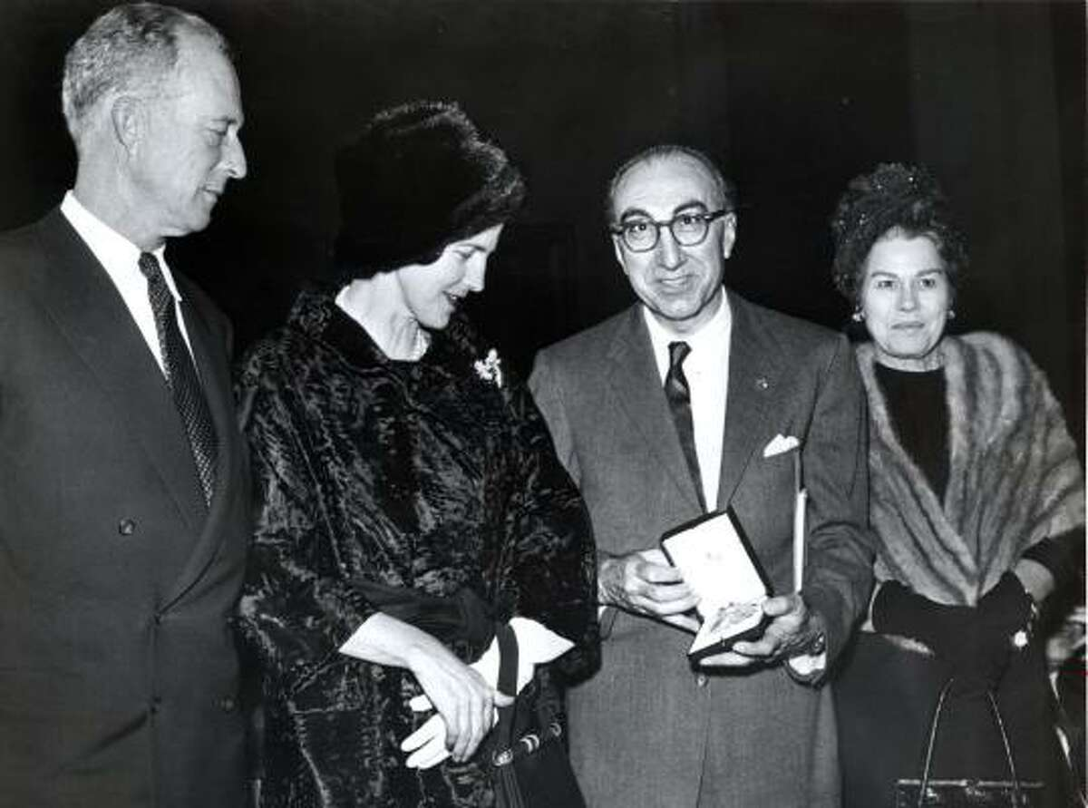 Michael DeBakey, with his first wife, Diana, at right, displays the the Grand Cross Order of Leopold he received from abdicated King Leopold, left, and Princess Lilian of Belgium in 1962.