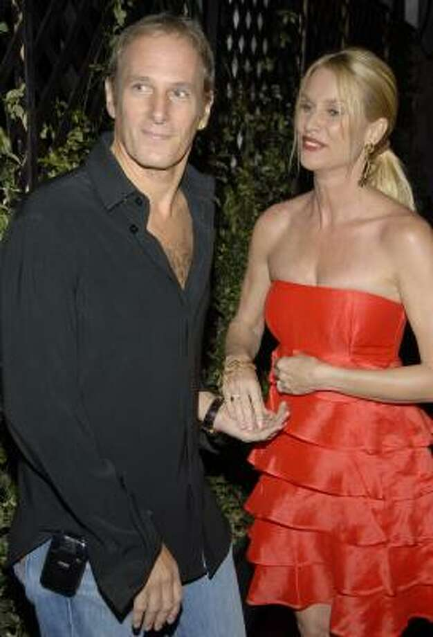 In this March 6, 2008 file photo, actress Nicollette Sheridan, right, and singer Michael Bolton pose on the press line at the grand opening celebration of Beso, a restaurant owned by actress Eva Longoria in Los Angeles. Photo: Dan Steinberg, AP