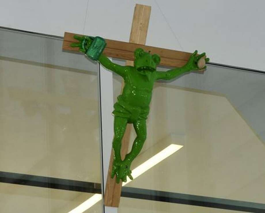 The Italian museum says the sculpture is an ironic self-portrait of the artist, not an affront to religion. Photo: OTHMAR SEEHAUSER, AP